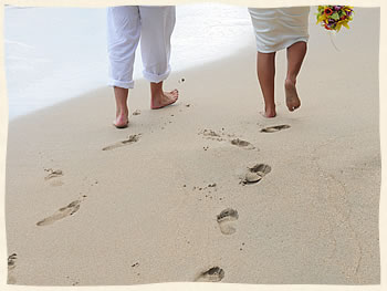 Island Wedding Couple making footprints in the sand