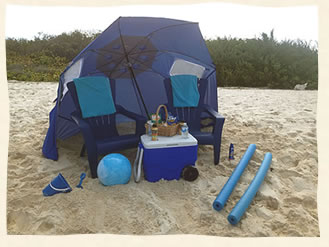 Beach umbrella, chairs, food and cooler for a relaxing time on the beach after your wedding.