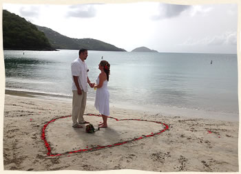 couple getting married at Magens Beach in rose petal heart