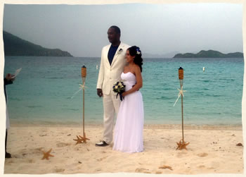 wedding ceremony at linduist beach with tiki torches