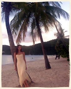 bride leaning on palm tree