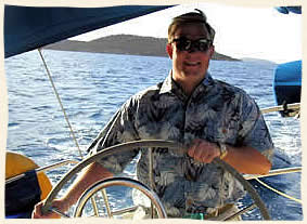 island groom at the helm