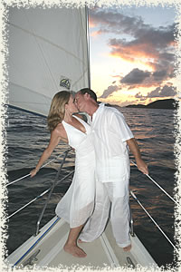 kiss on the bow sunset wedding