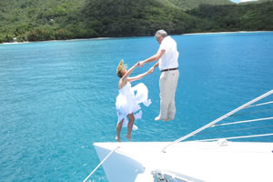 Jumping overboard after getting married on a sailboat in Hawksnest Harbour, St. John.