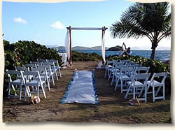 arch and aisle set up island wedding